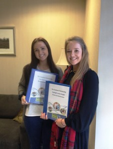 Zoe and Kayleigh with their SVQ folders
